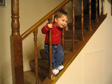 Andrew by himself on the stairs.  I just thought it was a cute picture.