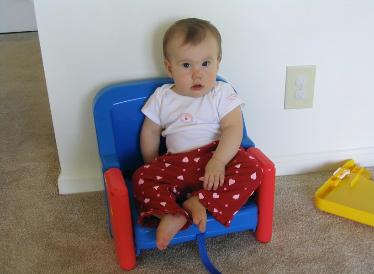 Before she had her hi-chair, Audrey had a booster seat.  I included this picture because it looks a lot like Laura in her baby pictures.