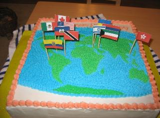 Yes, it was a big cake.  It took six cake mixes.  Laura did the top, I did the flags.  The top says Maligayang Paglalakbay, which is the rough equivalent of Happy Trails to You.