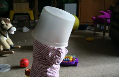 And this was the ice cream bucket.  She couldn't see where she was going, but she liked having it on her head!