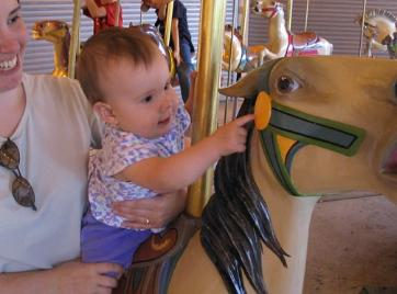 Two pics of Audrey on the carousel.  She's such a cutie!