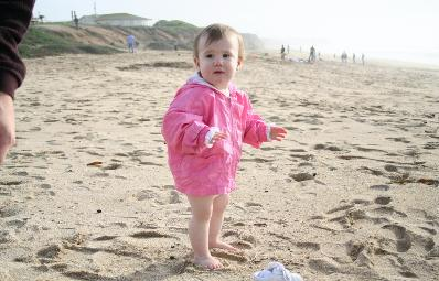 Audrey not so sure she likes the feel of sand under her feet...  I love her chicken legs in this picture!