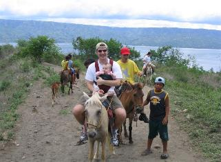 After the boat ride, you take horses to the rim of the inner volcano.  The horses are not meant for Americans...  Laura's guide was the coolest.  He sang to her the whole way down.