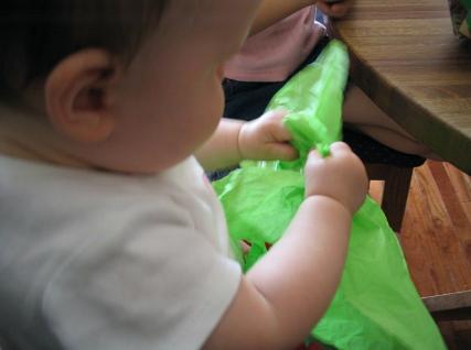 Audrey playing with some green tissue paper. Hey, anything to keep her happy.