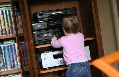 She helped Uncle Glen rearrange the stereo system so that she could push the buttons.