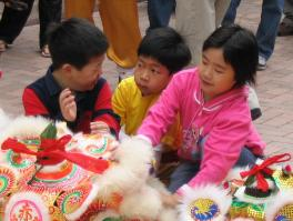 We went right after the Chinese New Year.  These kids were playing with a dragon costume in Stanley Market.