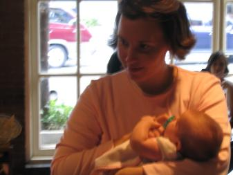 Laura holding Audrey at Chili's.  As a candid, this one is blurry if you make it bigger.