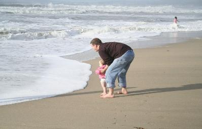 Daddy and Audrey by the waves.