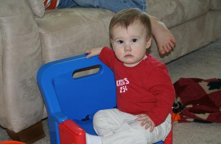 Audrey in her chair.  She loves this chair, and wo be unto the little kid who comes over and tries to sit in it.